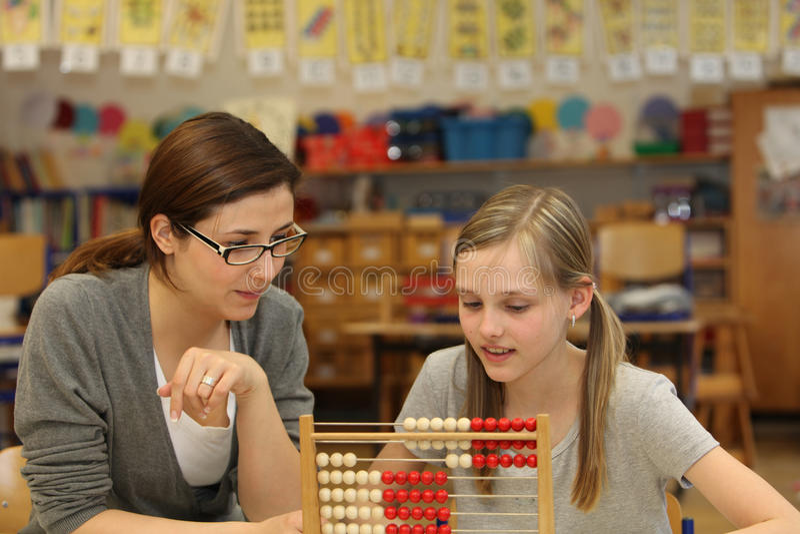 Student teacher explained a math question stock photos