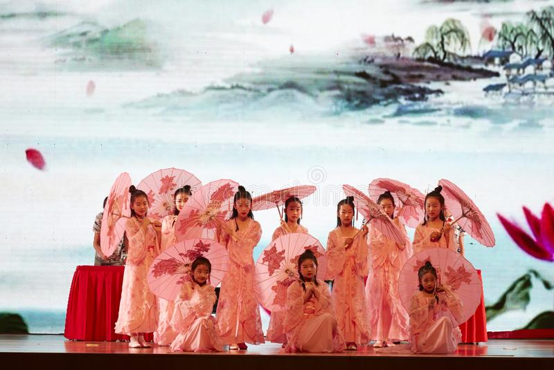 Student team performing Chinese Bamboo and oil paper umbrella dance stock photo