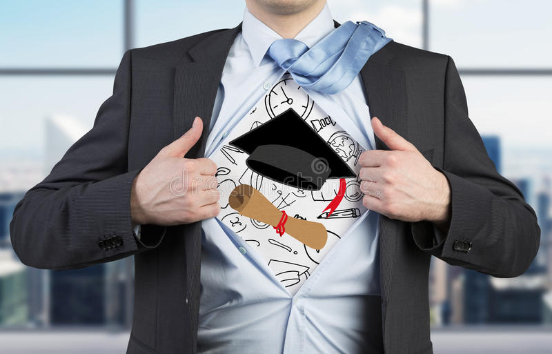 Student is tearing the shirt. Graduation attributes are drawn on the chest. The concept of the graduation. Young student is tearing the shirt. Graduation stock image