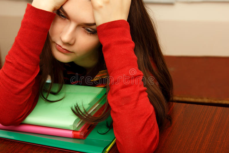 Student teen girl beautifyl tired inclassroom university royalty free stock photos