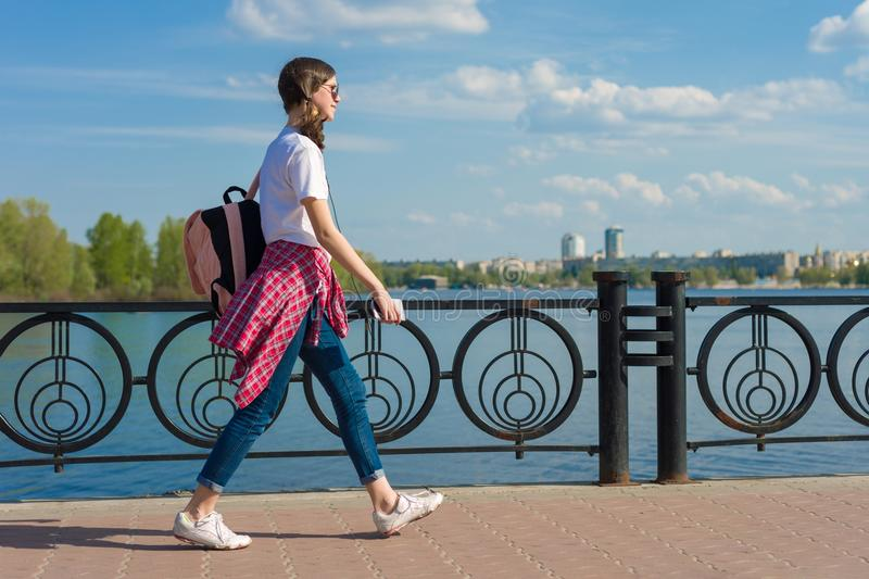 Student teen girl portrait with backpack outdoor in street smiling happy going back to school, copy space stock images