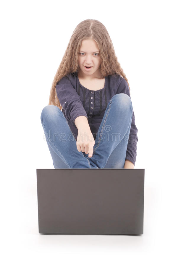 Student teenage girl sitting on the floor with laptop royalty free stock image
