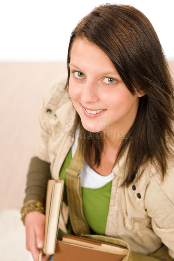 Student teenager girl holding books looking up stock photography
