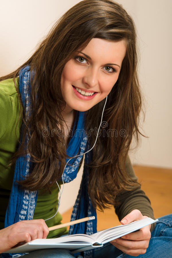 Download Student Teenager Woman Hold Book Listen Music Stock Image - Image: 24725629