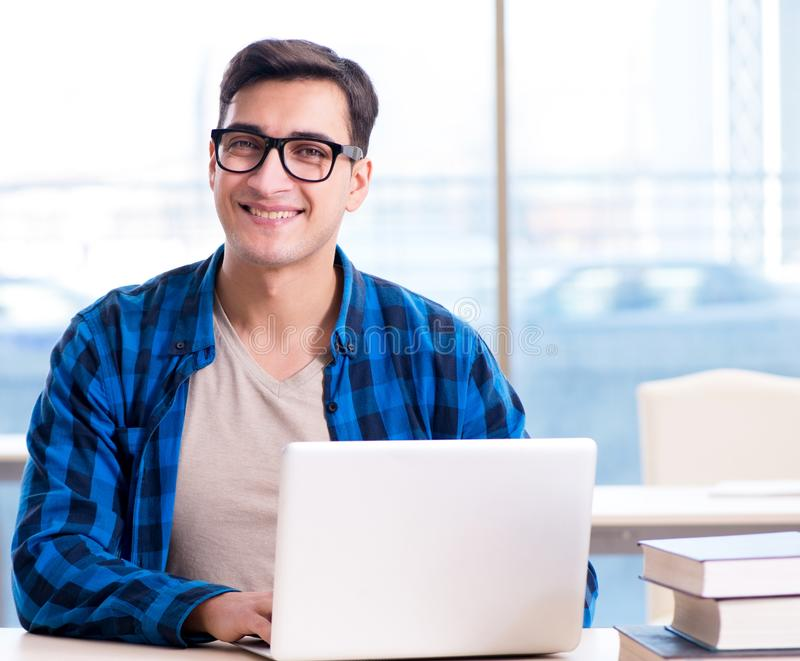 Student in telelearning distance learning concept reading in lib. Rary stock photo