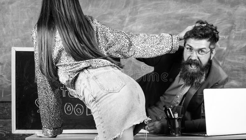 Student temptress. School behaviour discipline and rules. Sexy seduction. Teacher or school principal looking buttocks. Sexy girl student. Student in mini skirt royalty free stock photos