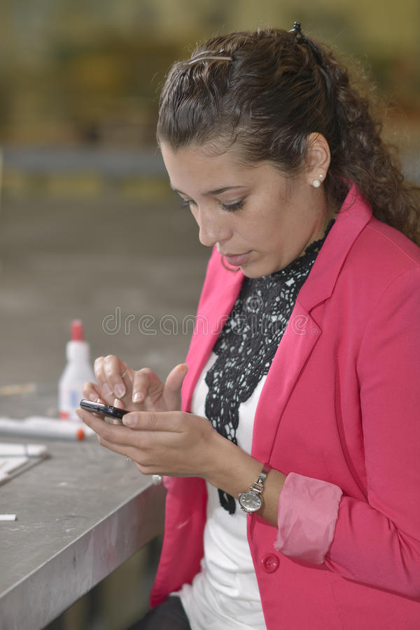 Student texting in design lab royalty free stock photography