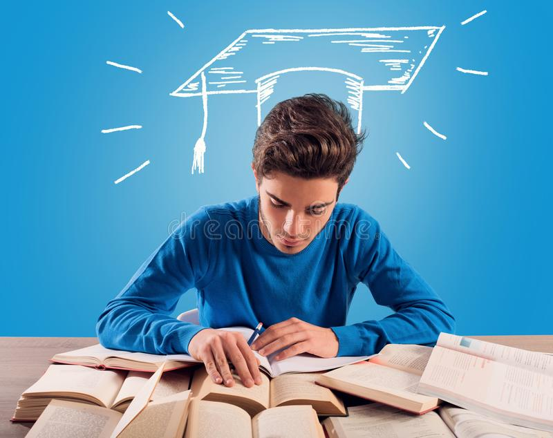 Student thinks about his graduation during the study royalty free stock images