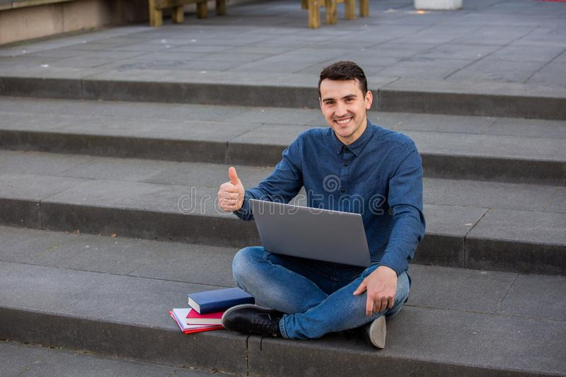 Student with thumb up gesture stock photos