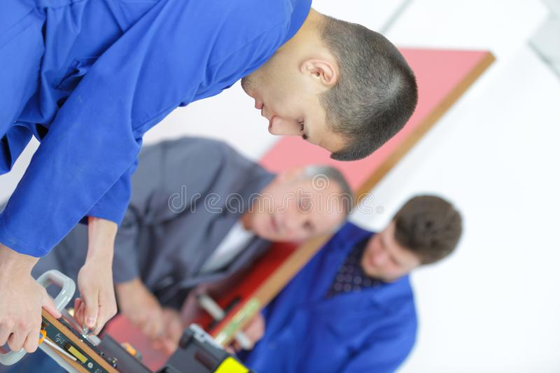 Student tradesmen at work. Student royalty free stock images