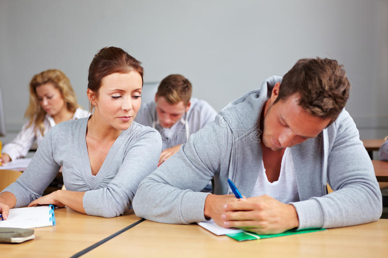 Student trying to cheat at test stock image