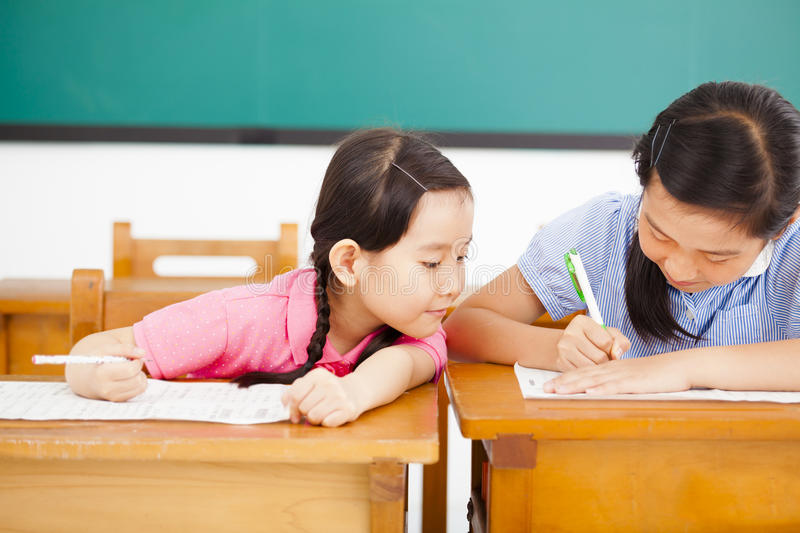 student trying to cheat at test in class stock image