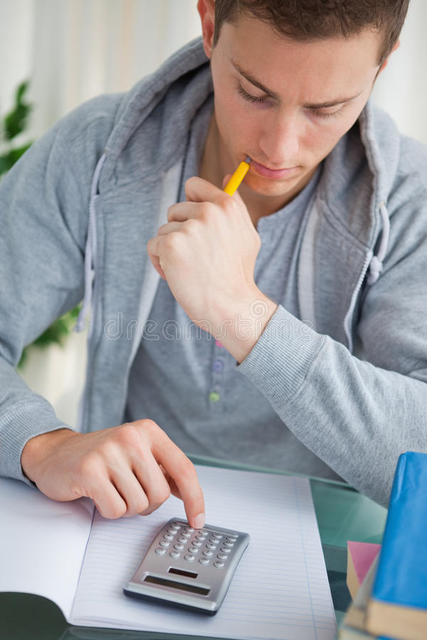 Download Student Using A Calculator Royalty Free Stock Image - Image: 25334826