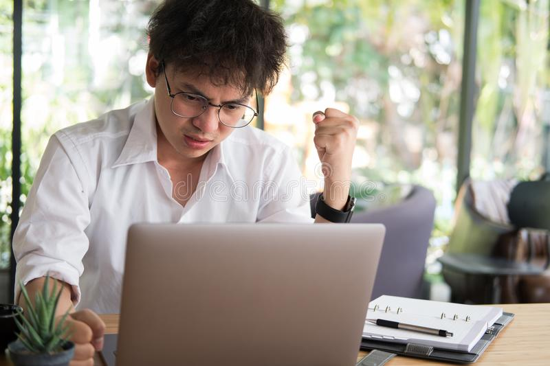 student using computer for learning leasson online at cafe. angry startup man working with laptop at office. young annoyed male royalty free stock photos