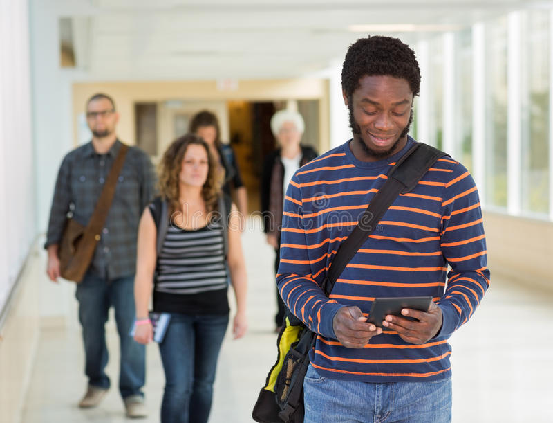 Student Using Digital Tablet Down University royalty free stock image