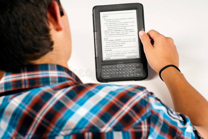 Student using an e-book royalty free stock photography