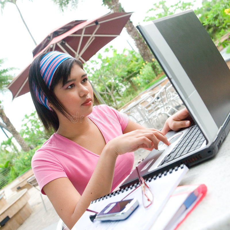student using her laptop computer stock photo