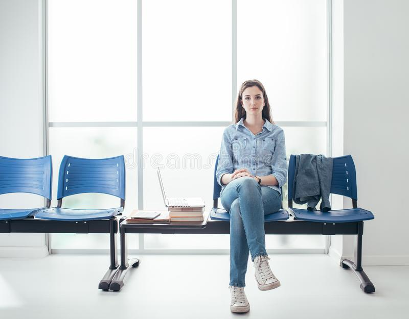 Student in the waiting room royalty free stock photography