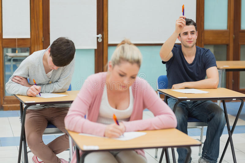 Student wanting to ask question in class stock photos