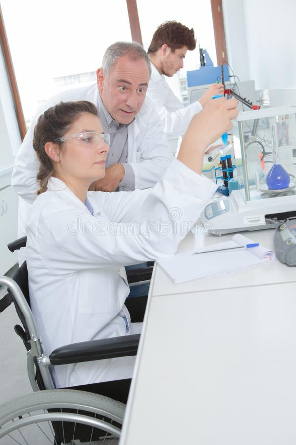 Student on wheelchair doing research. Student on the wheelchair doing research stock photos
