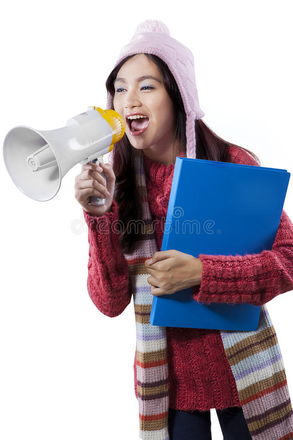Student in winter clothes shout with megaphone stock photography