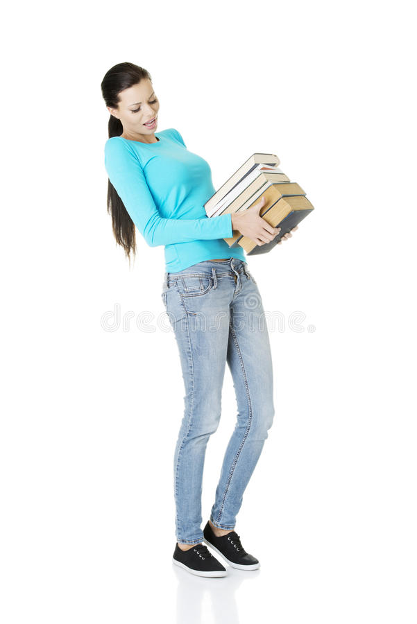 Download Student Woman Holding Heavy Books Stock Photo - Image of cute, female: 28735662