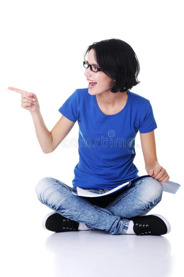 Student woman pointing on copy space.