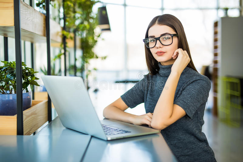 Student work process concept. Woman working university project with generic design laptop. Student work process concept. Young woman working university project royalty free stock photo