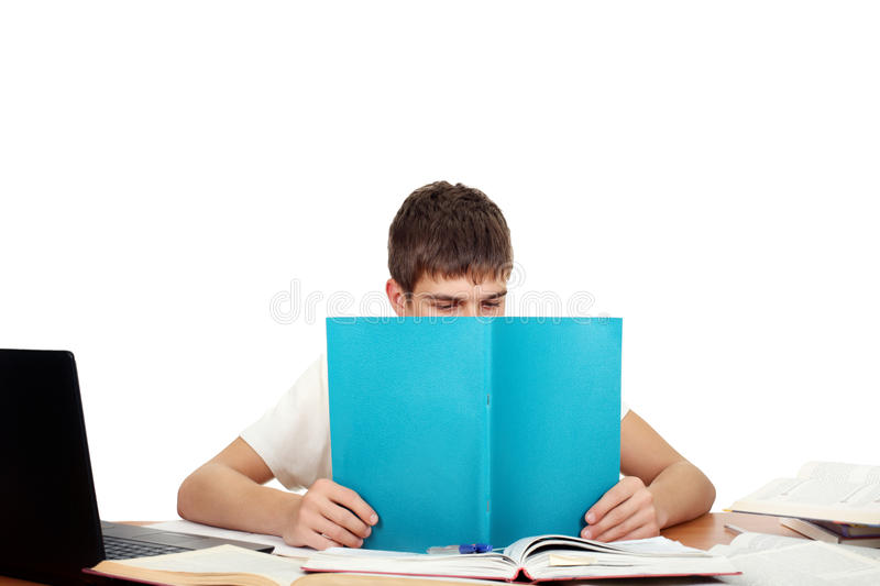 Student With Workbook. Student reads workbook on the School Desk. Isolated on the White Background stock photos