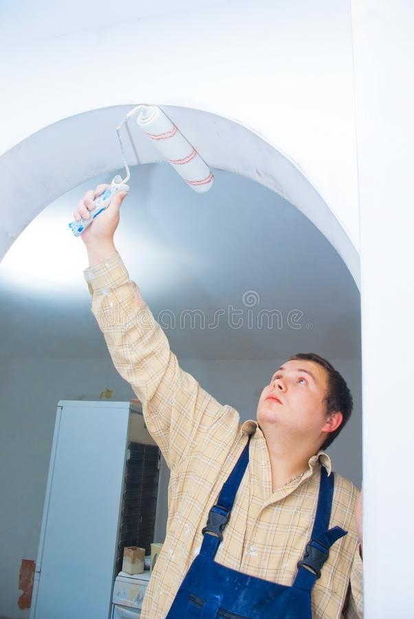 Student worker paint the arc royalty free stock images