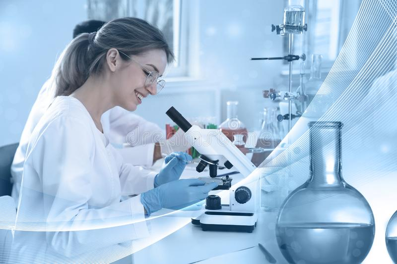 Student working in modern scientific laboratory. Experimental chemistry. Student working in modern scientific laboratory, double exposure. Experimental chemistry royalty free stock photos