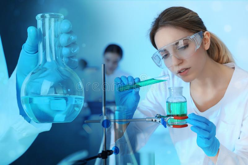Student working in modern scientific laboratory. Experimental chemistry. Student working in modern scientific laboratory, double exposure. Experimental chemistry stock photography