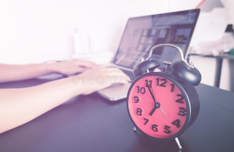 Student is working on project with alarm clock royalty free stock photos