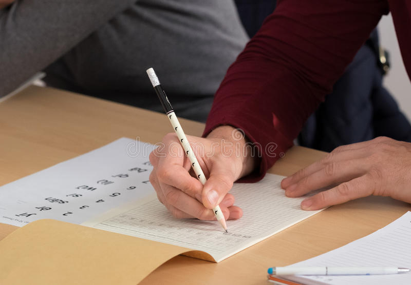 Student writing Chinese characters royalty free stock image