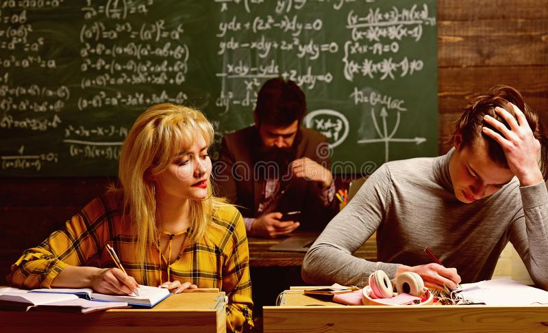 Student writing composition for annual exams preparation. Making time for fun allows students to study better. Best royalty free stock photo