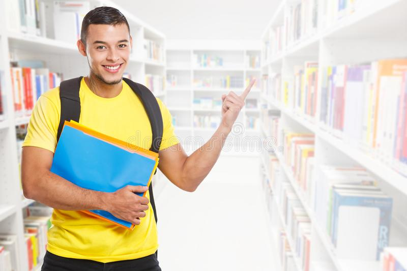 Student young man education showing pointing copyspace copy space library marketing information ad advert people. Learning royalty free stock photography