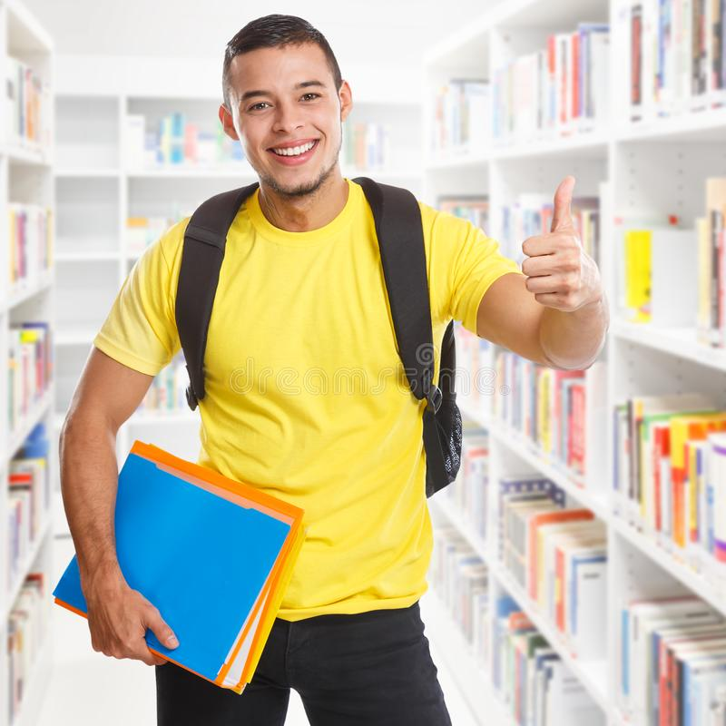Student young man success successful library square learning thumbs up smiling people. Learn royalty free stock photo