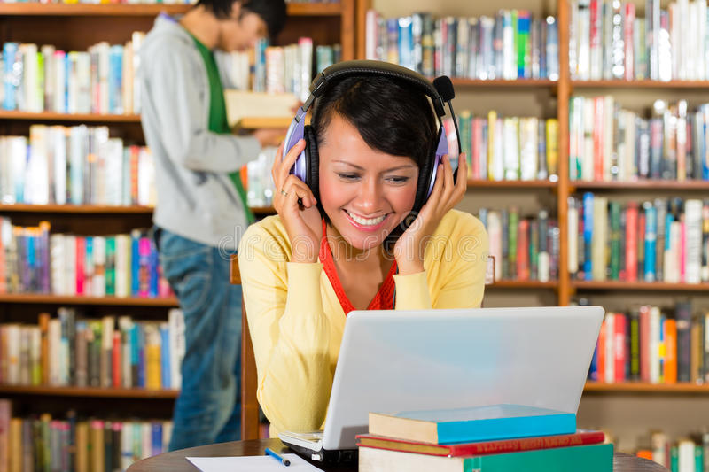 Download Woman In Libary With Laptop Stock Photo - Image: 29801368