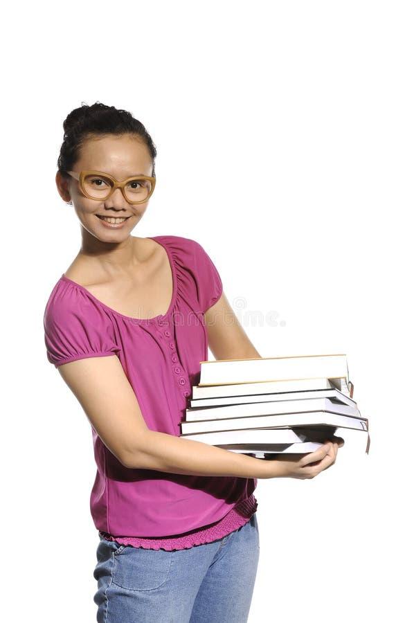 Studenta Collegu przewożenia sterta książki obrazy stock