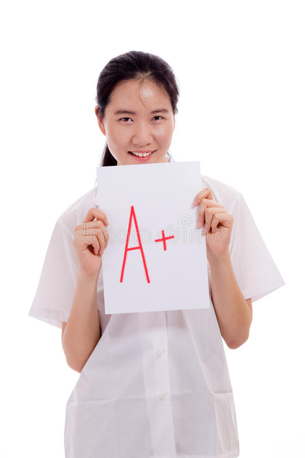 Studente asiatico della High School della ragazza che mostra prova fotografie stock