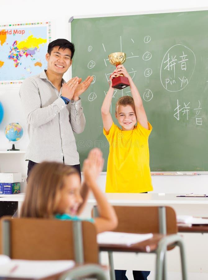 Studente cinese dell'insegnante fotografia stock