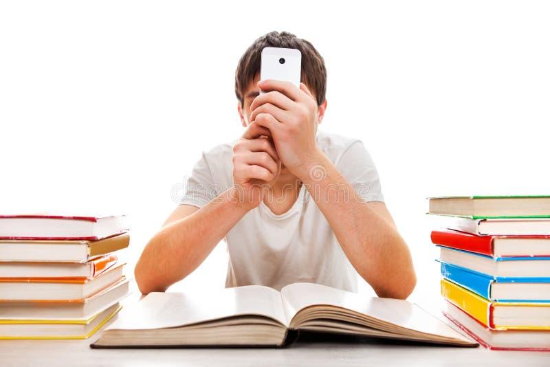 Studente con un telefono immagini stock
