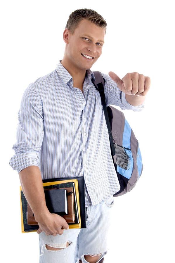 Studente di college con i libri e lo zaino fotografie stock libere da diritti