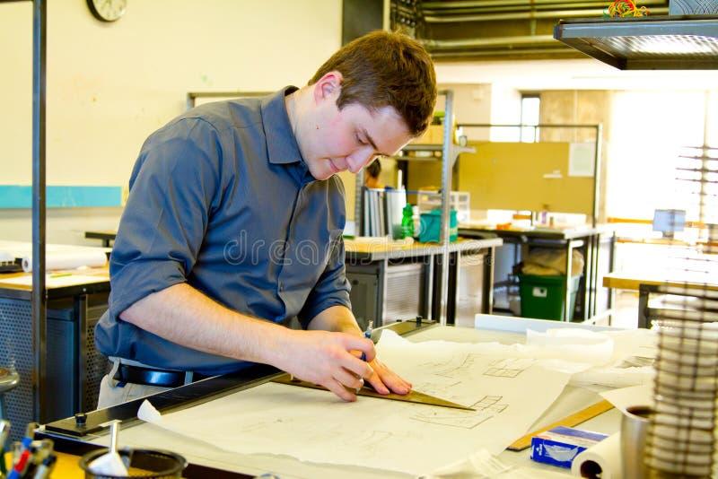 Studente di college Drafting Architecture immagini stock