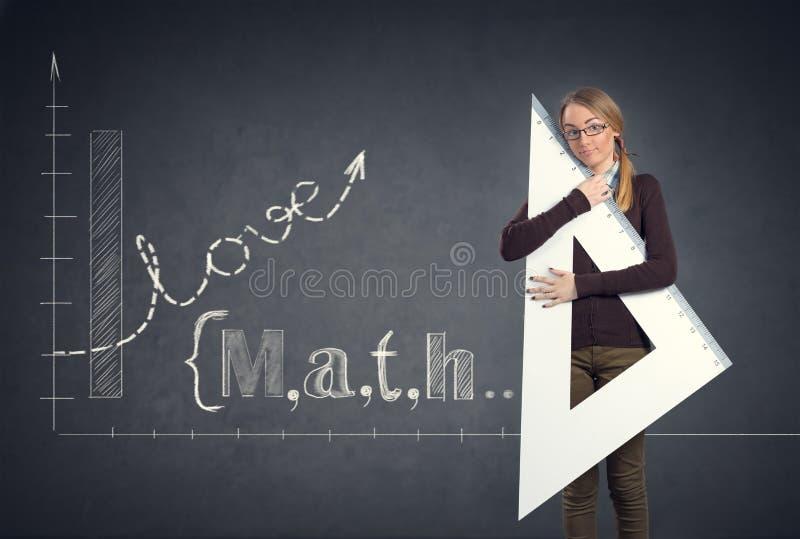 Studenten älskar matematik arkivfoto