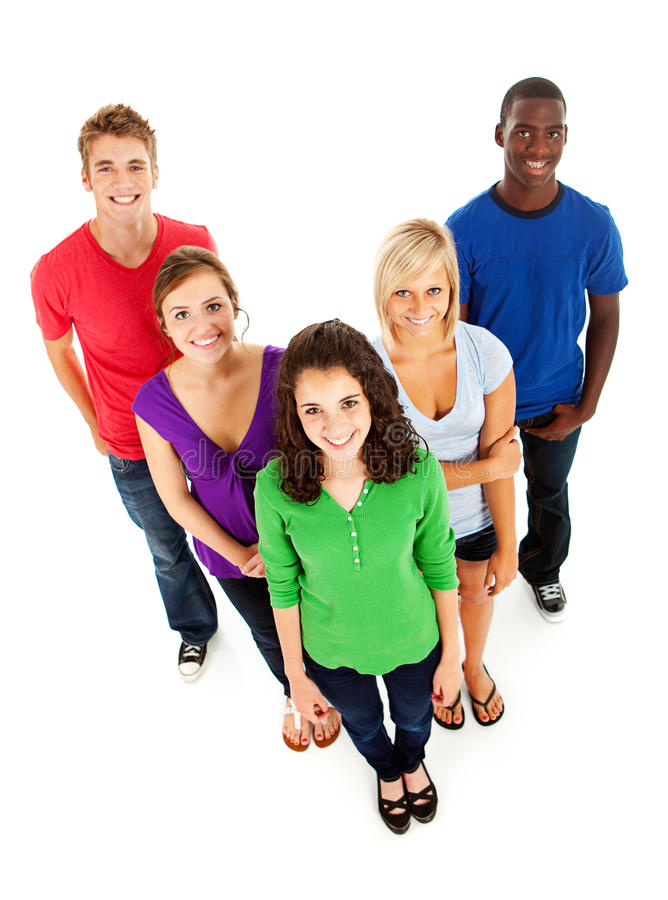 Studenten: Glimlachende Multi-etnische Groep Tieners stock afbeelding