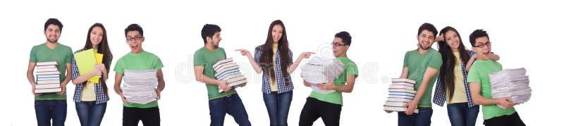 Studenten met boeken die op wit worden ge?soleerde royalty-vrije stock foto's