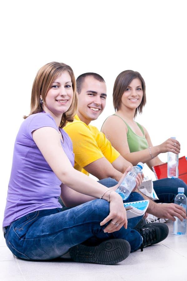 Studenten met flessen water royalty-vrije stock foto