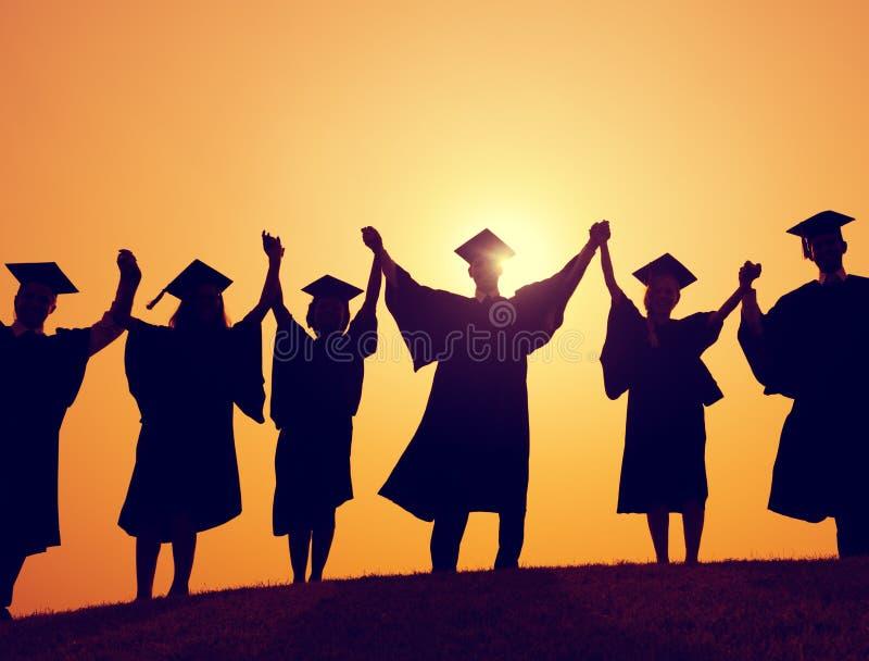 Studenten-Staffelungs-Erfolgs-Leistungs-Feier-Konzept stockfotografie