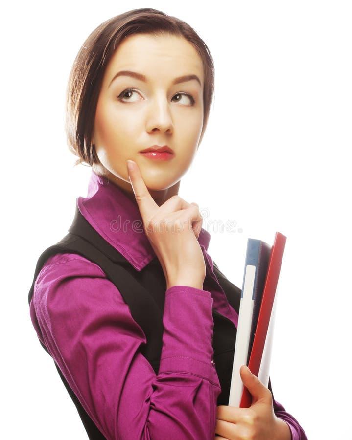 Studentenfrau mit Ordnern lizenzfreie stockbilder